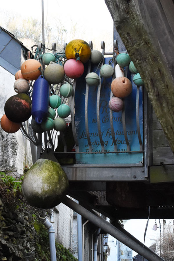 buoys on balcony in polperro in cornwall