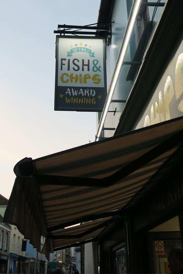 harbour lights fish and chips sign and shop front in falmouth in cornwall