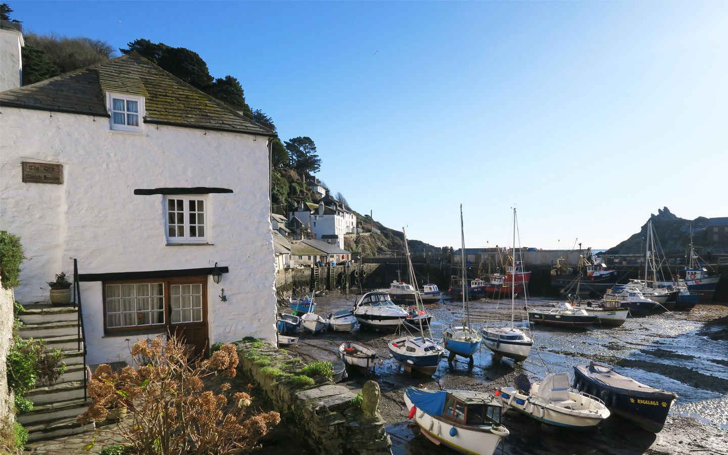 tide out in polperro harbour in cornwall