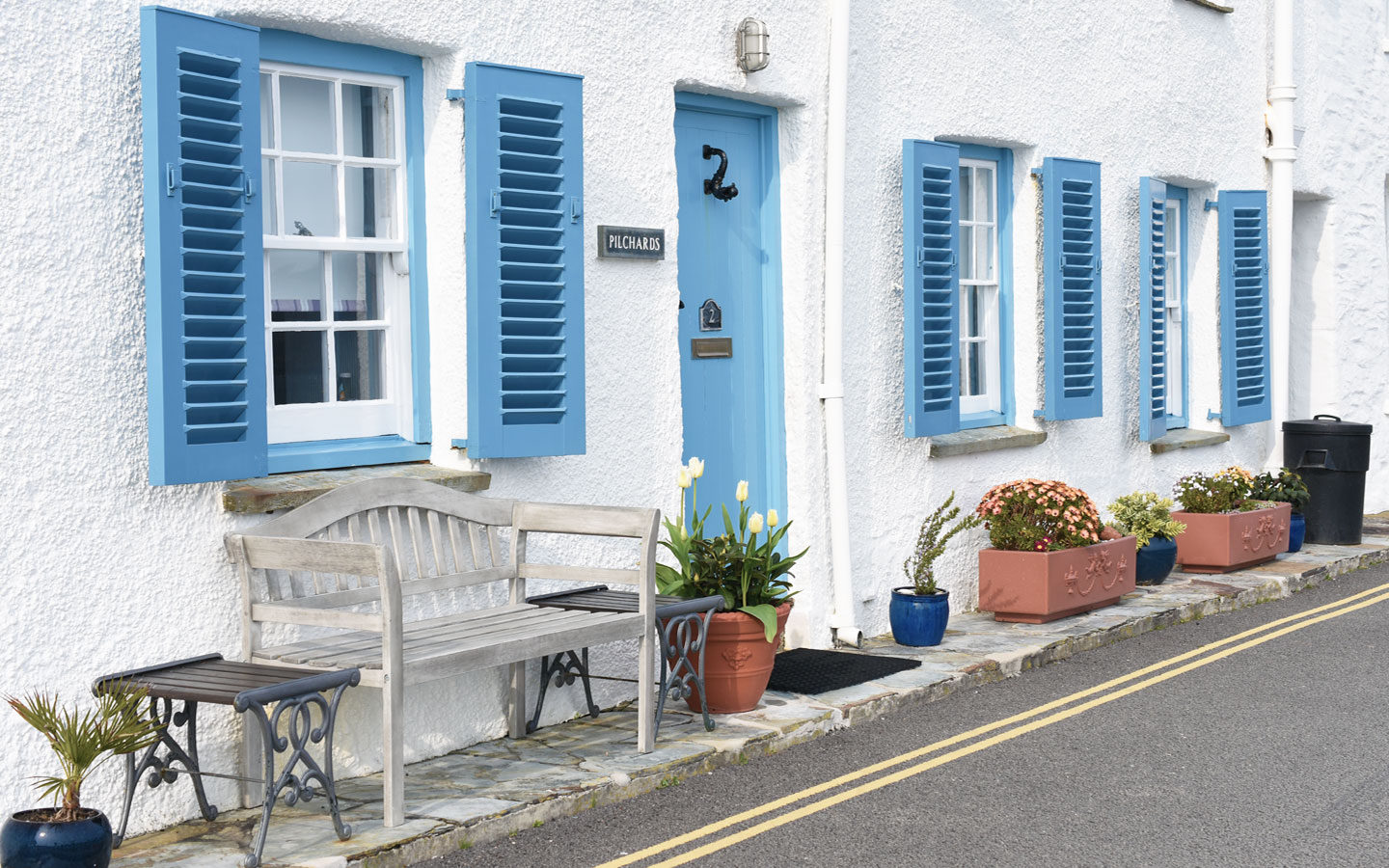 pilchards cottage with blue door and shutters in saint mawes in cornwall