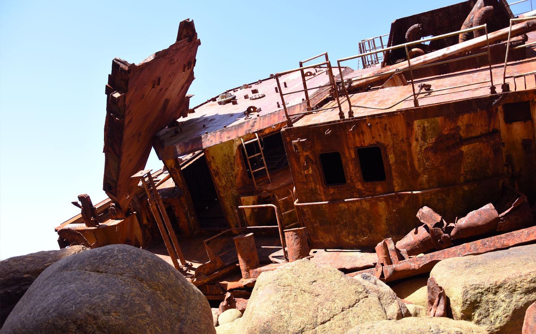 rusty ship washed up on a cornish beach