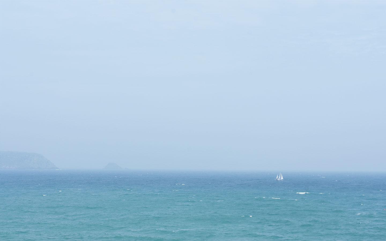 sail boat at sea at rosevine in cornwall